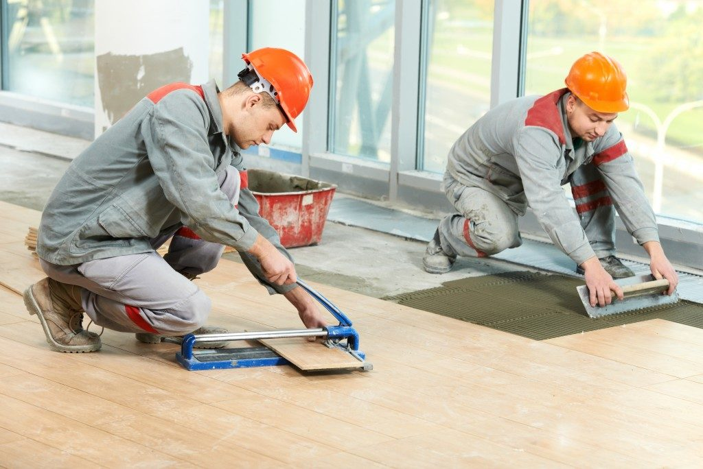 Construction Workers Tiling