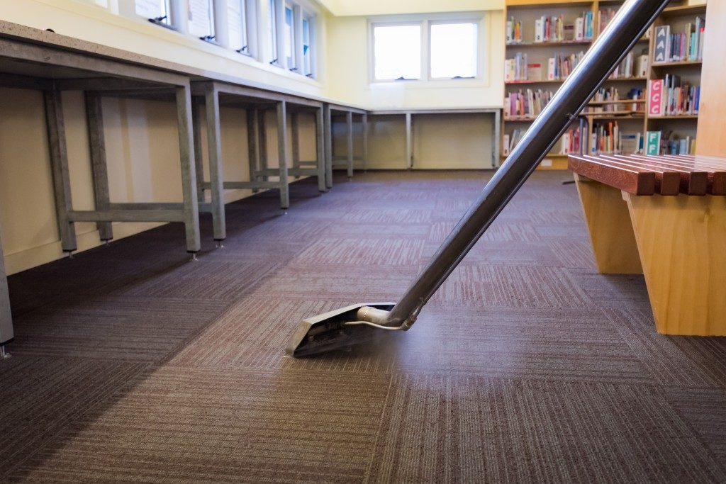 Steam cleaning the carpet in the library