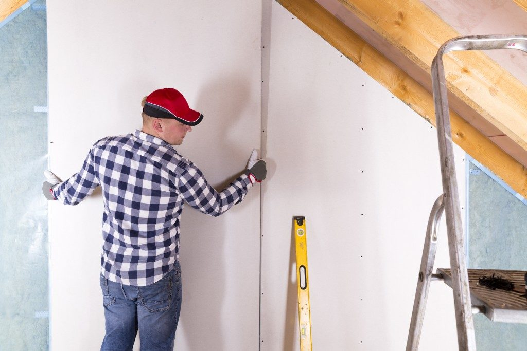 man installing a panel