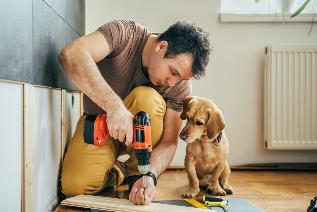 Man building home with his dog