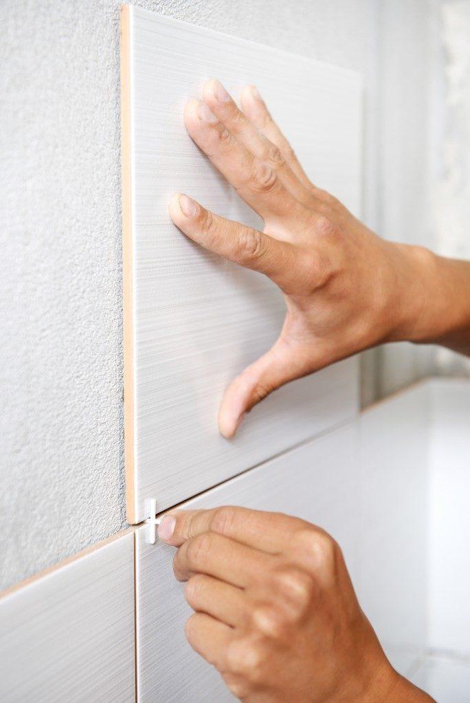 Man putting Tile