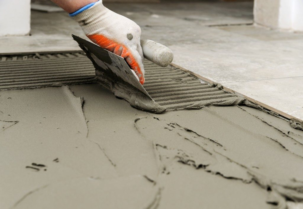 Worker smoothening concrete