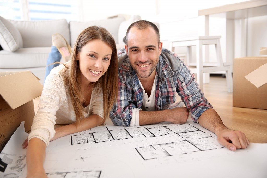 Couple with their floor plan