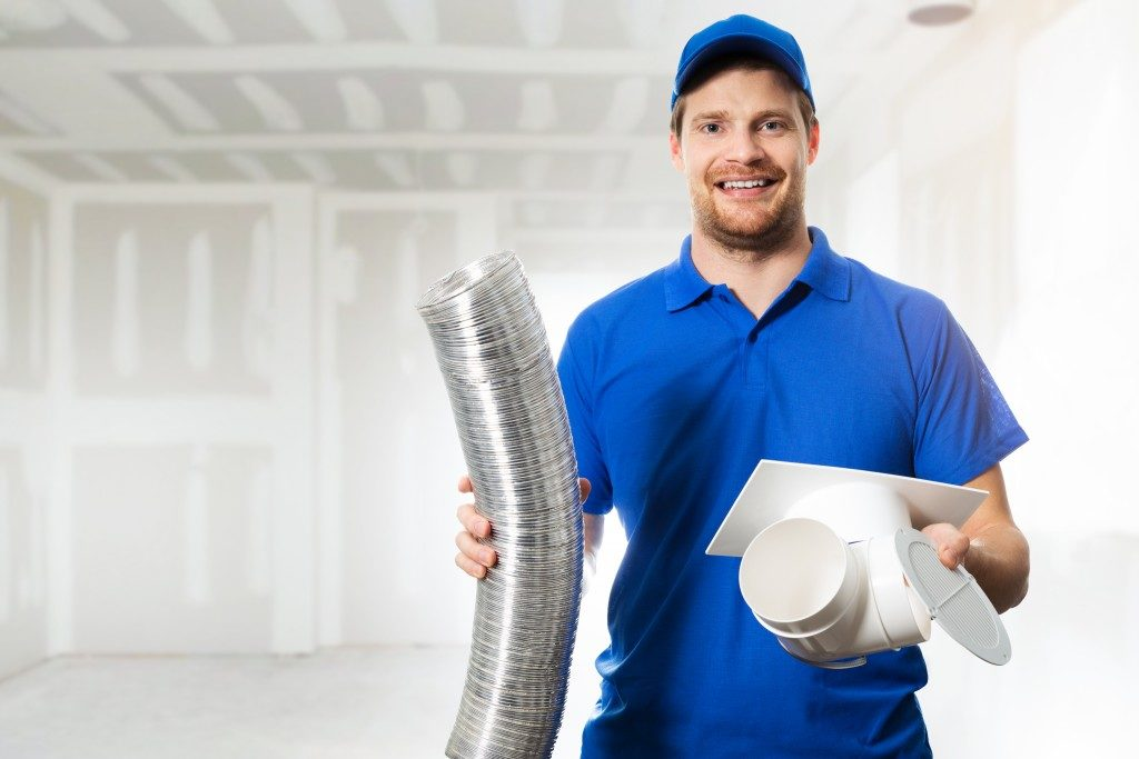 man holding a clean air duct and filter