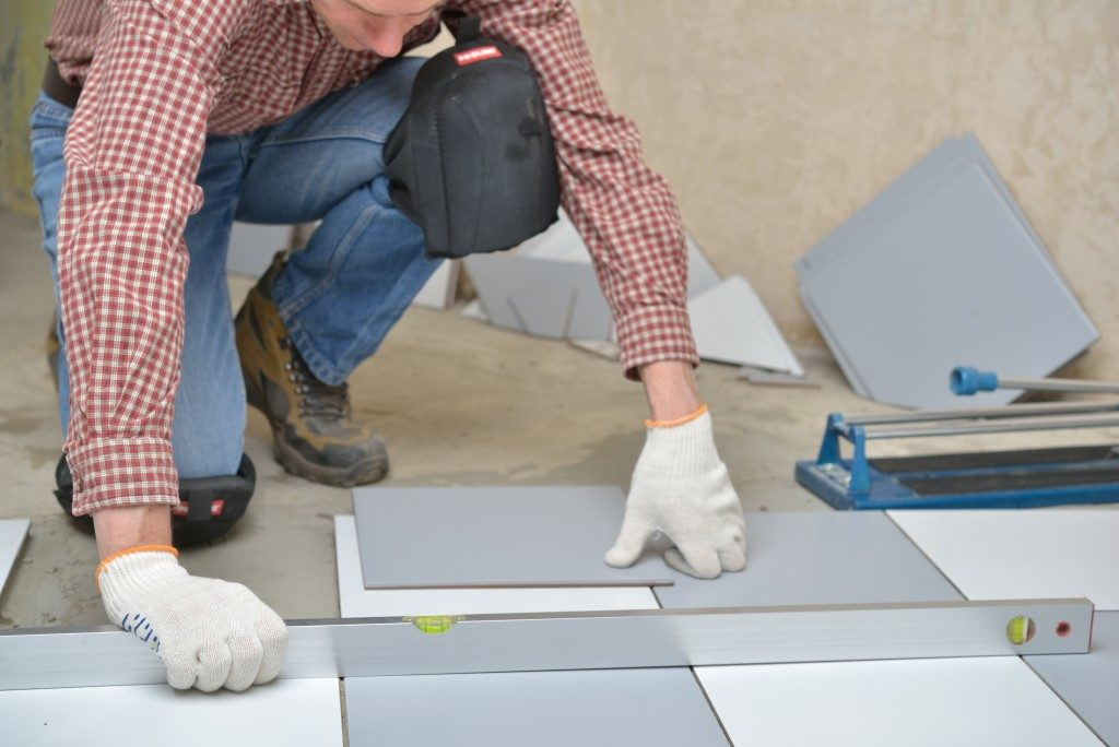 placing tiles on the floor