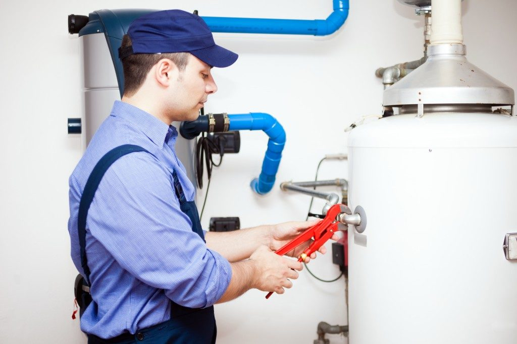 plumbing inspecting water heater