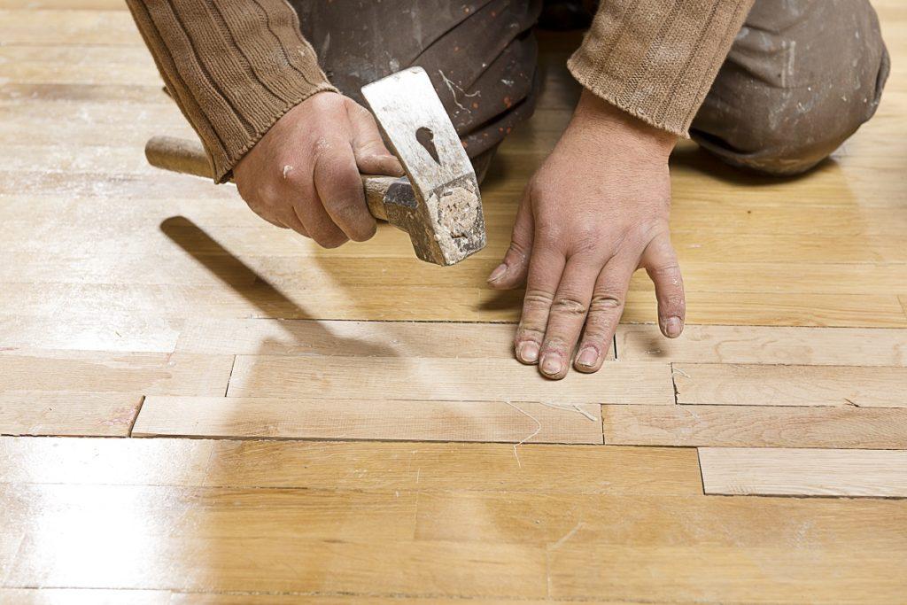 Man assembling hardwood floor