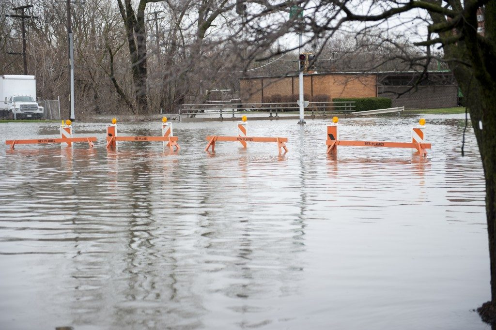 Flooded street with road barriers