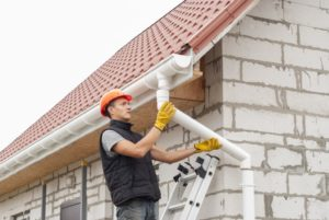 Man fixing gutter