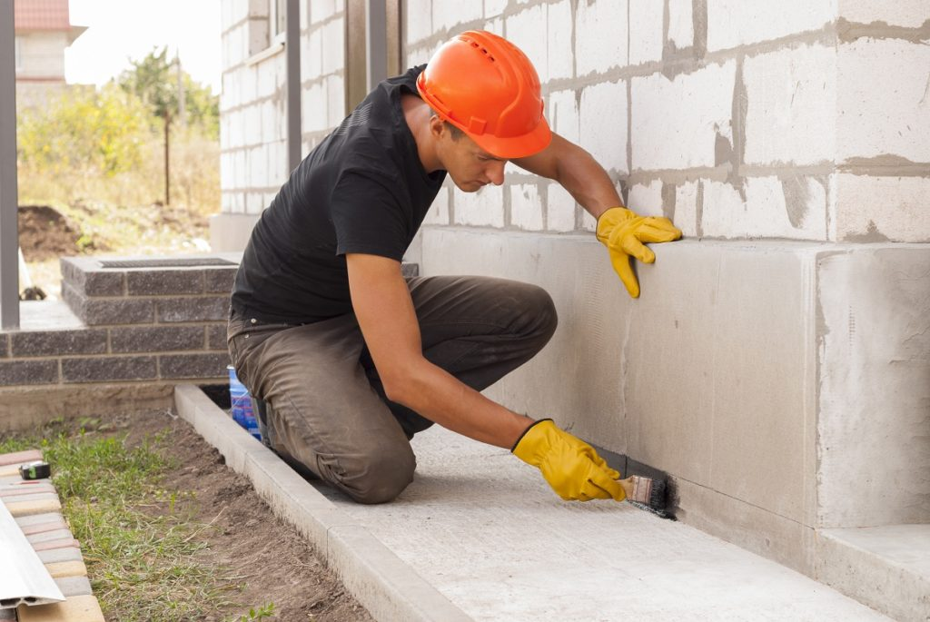 Man working on house foundation