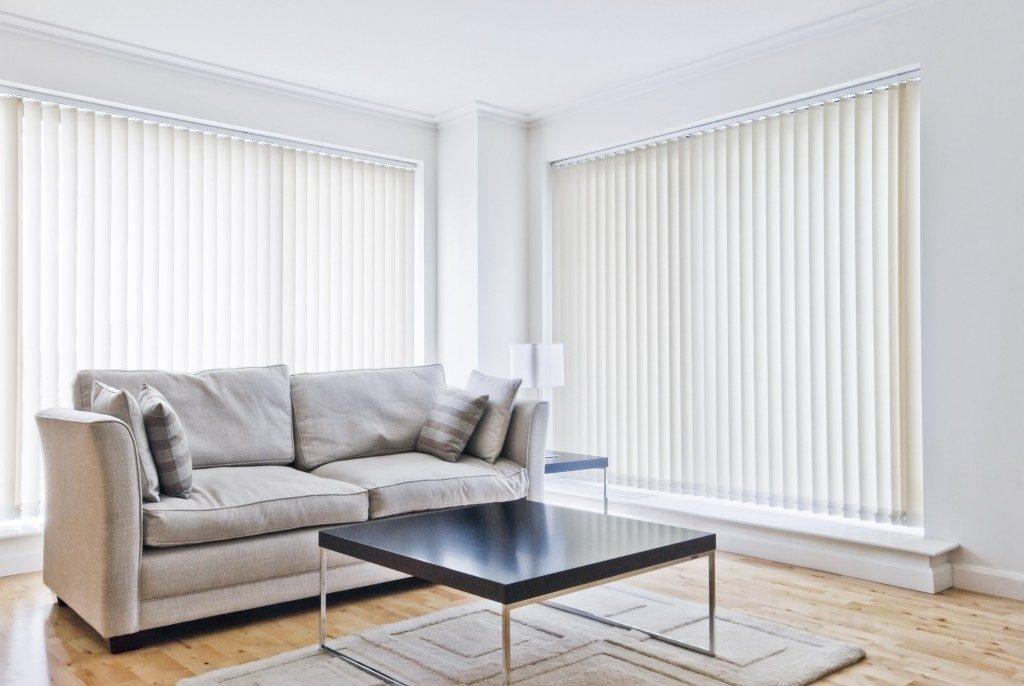 white blinds installed in the living room windows
