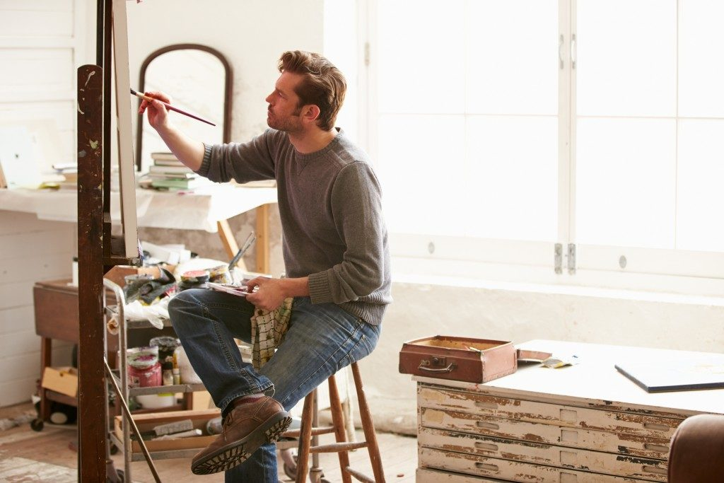 Man painting in his studio