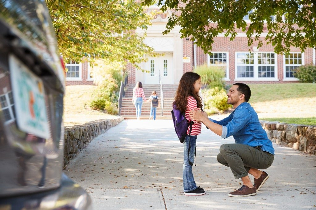 Dad with daughter on her first day in a new school
