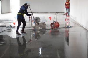 construction applying epoxy on the floor
