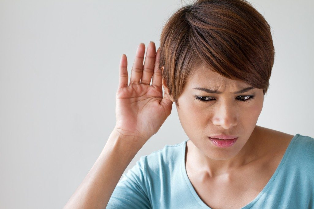 woman suffering from hearing impairment