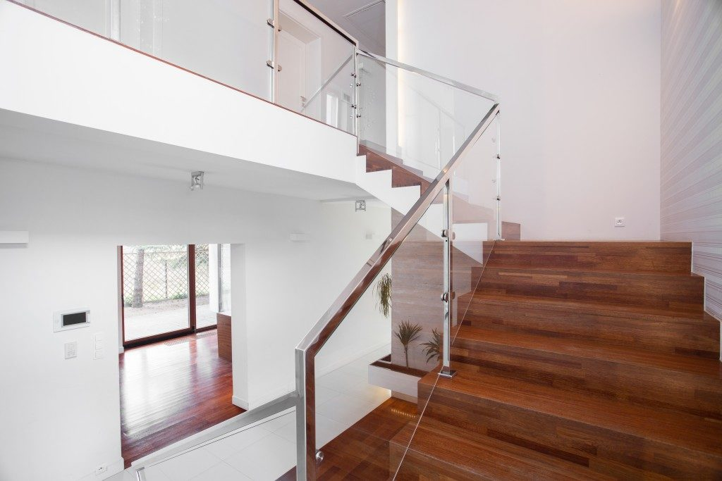 mage of solid wooden stairs with elegant glass balustrade