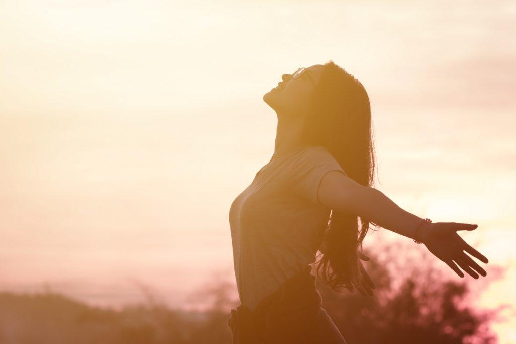 girl embracing the sunlight
