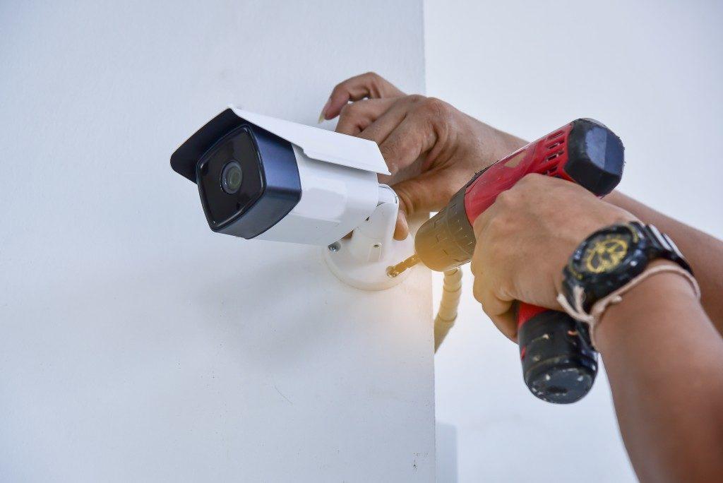 man installing a cctv camera