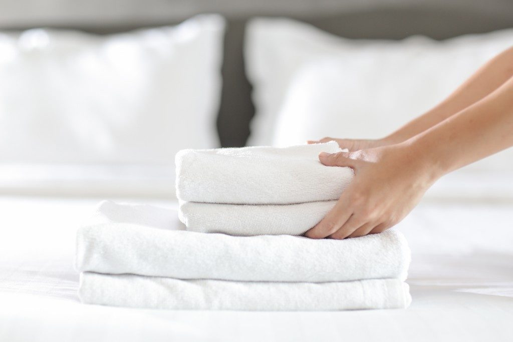 fresh linen on top of bed